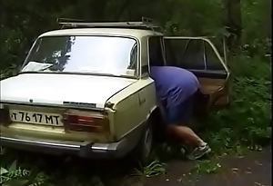 Russian couple is fucked by car in the matter of the sticks