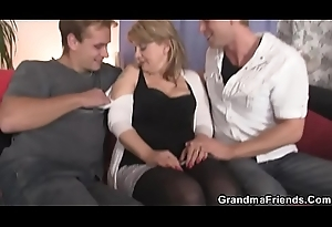 Mature coddle in nylons swallows a handful of schlongs