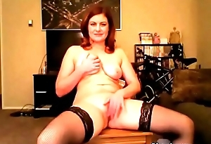 Busty redhead milf masturbates on be transferred to chair
