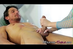 Lovely masseuse receives cream